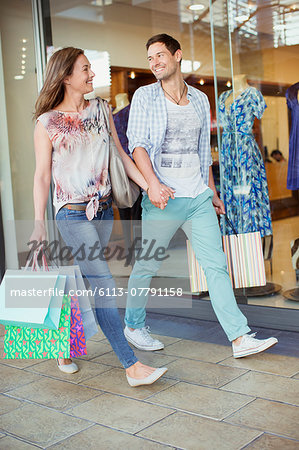 Couple shopping together in shopping mall Stock Photo - Premium Royalty-Free, Image code: 6113-07791158