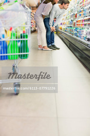 Couple shopping together in grocery store Stock Photo - Premium Royalty-Free, Image code: 6113-07791226
