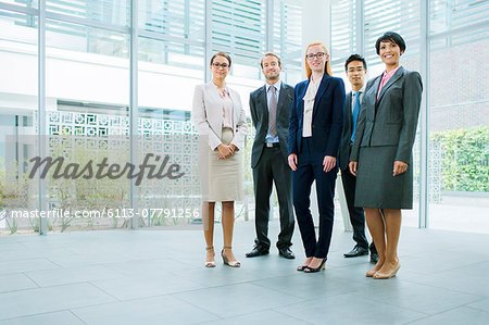 Business people gathered in office building Stock Photo - Premium Royalty-Free, Image code: 6113-07791256