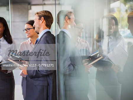 Business people talking in office building Stock Photo - Premium Royalty-Free, Image code: 6113-07791271