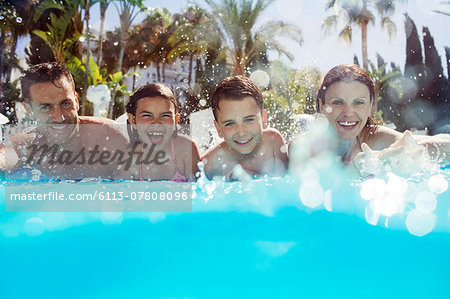 Portrait of family with two children in swimming pool Stock Photo - Premium Royalty-Free, Image code: 6113-07808096