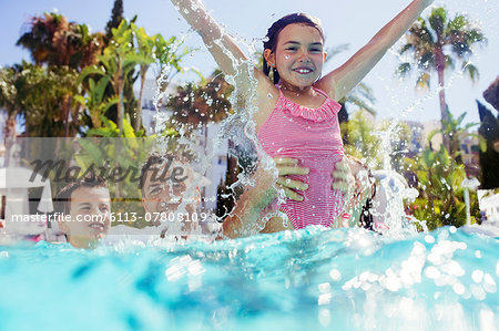 Father playing with son and daughter in swimming pool Stock Photo - Premium Royalty-Free, Image code: 6113-07808109