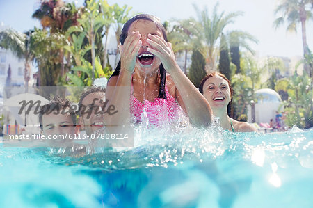 Family with two children enjoying themselves in swimming pool Stock Photo - Premium Royalty-Free, Image code: 6113-07808114