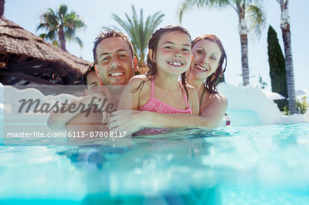 Portrait of happy family with son and daughter in swimming pool Stock Photo - Premium Royalty-Free, Image code: 6113-07808117