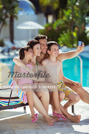 Family with two children taking selfie by swimming pool Stock Photo - Premium Royalty-Free, Image code: 6113-07808123