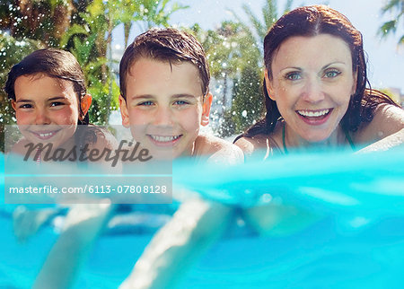 Portrait of mother with her two children in swimming pool Stock Photo - Premium Royalty-Free, Image code: 6113-07808128