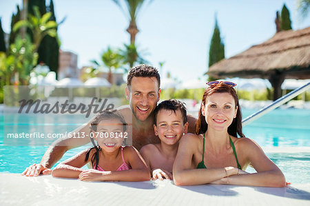 Portrait of family with two children in swimming pool Stock Photo - Premium Royalty-Free, Image code: 6113-07808142