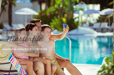 Family with two children taking selfie by swimming pool Stock Photo - Premium Royalty-Free, Image code: 6113-07808149