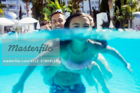 Portrait of girl and her father in swimming pool Stock Photo - Premium Royalty-Free, Image code: 6113-07808154