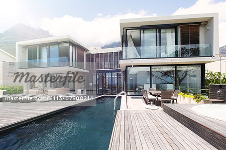 Modern house with large patio and swimming pool Stock Photo - Premium Royalty-Free, Image code: 6113-07808214