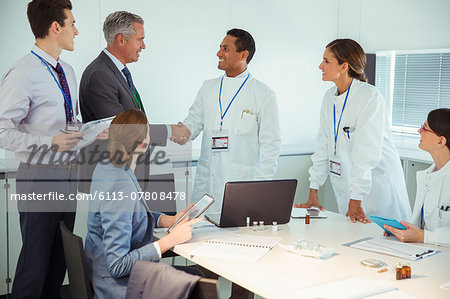 Scientists and business people talking in conference room Stock Photo - Premium Royalty-Free, Image code: 6113-07808478