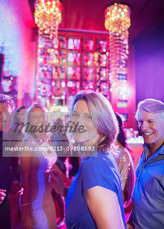 Happy mature people having fun in nightclub Stock Photo - Premium Royalty-Free, Image code: 6113-07808592