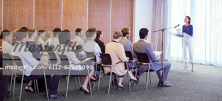 Young woman delivering speech before audience in conference room Stock Photo - Premium Royalty-Free, Image code: 6113-07906090