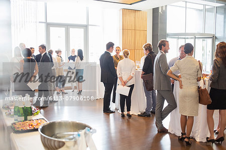 Group of conference participants standing in lobby of conference center, socializing during lunch break Stock Photo - Premium Royalty-Free, Image code: 6113-07906108