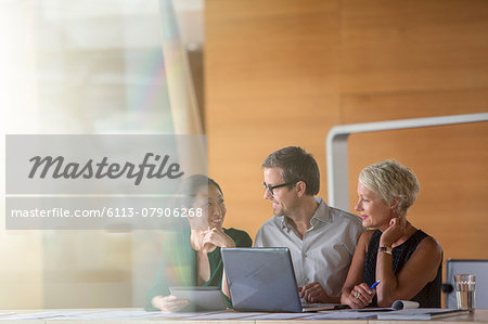 Business people talking in office meeting Stock Photo - Premium Royalty-Free, Image code: 6113-07906268