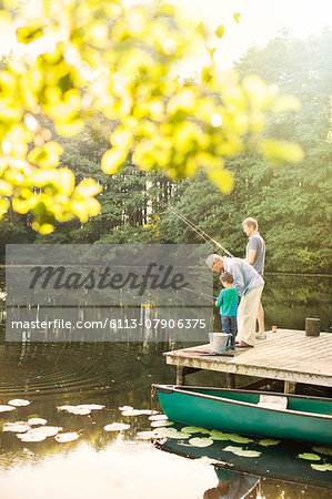 Boy, father and grandfather fishing in lake Stock Photo - Premium Royalty-Free, Image code: 6113-07906375