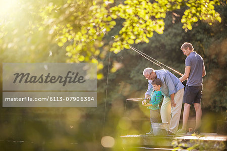 Boy, father and grandfather fishing in lake Stock Photo - Premium Royalty-Free, Image code: 6113-07906384