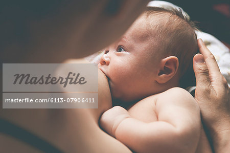 Mother holding and breast-feeding little baby Stock Photo - Premium Royalty-Free, Image code: 6113-07906411