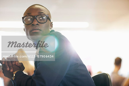 University student sitting in classroom Stock Photo - Premium Royalty-Free, Image code: 6113-07906434
