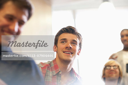 Motivated university students at seminar in classroom Stock Photo - Premium Royalty-Free, Image code: 6113-07906446