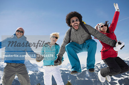 Portrait of exuberant friends in snow Stock Photo - Premium Royalty-Free, Image code: 6113-07906578