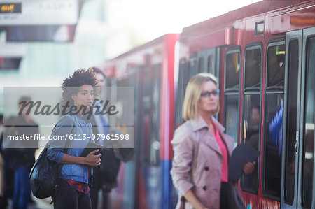 People boarding train Stock Photo - Premium Royalty-Free, Image code: 6113-07961598