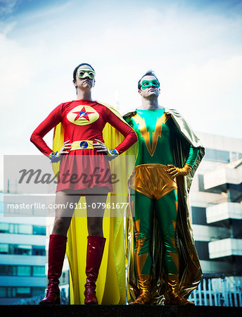 Superheroes standing on city rooftop Stock Photo - Premium Royalty-Free, Image code: 6113-07961677