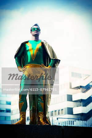 Superhero standing near city skyline Stock Photo - Premium Royalty-Free, Image code: 6113-07961701