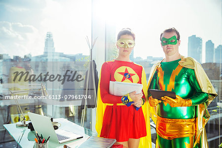 Superheroes standing in office Stock Photo - Premium Royalty-Free, Image code: 6113-07961704