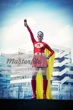 Superhero standing proudly in city Stock Photo - Premium Royalty-Free, Image code: 6113-07961751