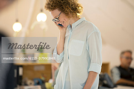 Portrait of woman talking on phone Stock Photo - Premium Royalty-Free, Image code: 6113-07991840