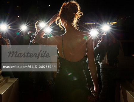Silhouette of celebrity being photographed by paparazzi Stock Photo - Premium Royalty-Free, Image code: 6113-08088144