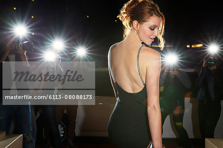 Celebrity in black dress being photographed by paparazzi photographers Stock Photo - Premium Royalty-Free, Image code: 6113-08088173