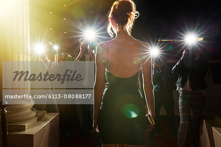 Silhouette of celebrity in black dress being photographed by paparazzi Stock Photo - Premium Royalty-Free, Image code: 6113-08088177