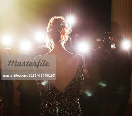 Celebrity facing paparazzi photographers at event Stock Photo - Premium Royalty-Free, Image code: 6113-08088183