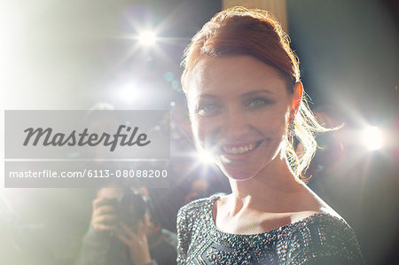 Close up portrait of smiling celebrity being photographed at paparazzi event Stock Photo - Premium Royalty-Free, Image code: 6113-08088200