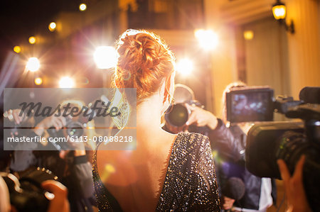 Celebrity being photographed by paparazzi photographers at event Stock Photo - Premium Royalty-Free, Image code: 6113-08088218
