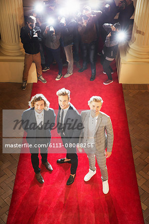 Portrait of smiling celebrities posing on red carpet Stock Photo - Premium Royalty-Free, Image code: 6113-08088256