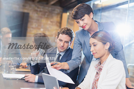 Business people with paperwork and digital tablet in conference room Stock Photo - Premium Royalty-Free, Image code: 6113-08184325