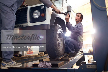 mechanics working in auto repair shop Stock Photo - Premium Royalty-Free, Image code: 6113-08184378