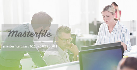 Business people working at computer in office Stock Photo - Premium Royalty-Free, Image code: 6113-08220301