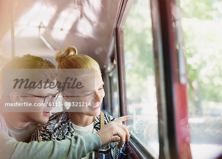 Couple drawing on bus window Stock Photo - Premium Royalty-Free, Image code: 6113-08321214