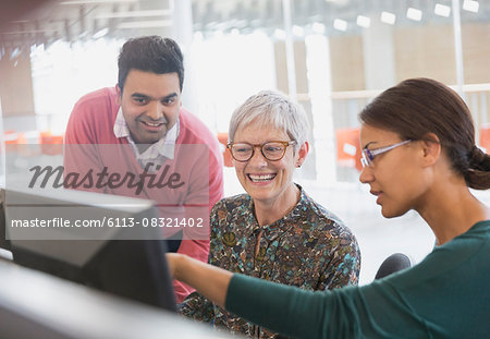 Business people working at computer in office Stock Photo - Premium Royalty-Free, Image code: 6113-08321402