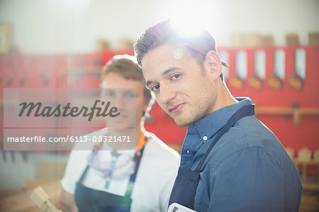 Portrait confident carpenter in workshop Stock Photo - Premium Royalty-Free, Image code: 6113-08321471