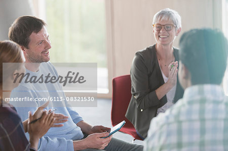 Smiling business people talking in meeting Stock Photo - Premium Royalty-Free, Image code: 6113-08321530