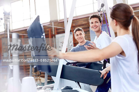 Physical therapists with man on treadmill Stock Photo - Premium Royalty-Free, Image code: 6113-08521464