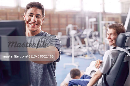 Physical therapist at computer talking to man Stock Photo - Premium Royalty-Free, Image code: 6113-08521465