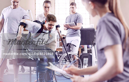 Man with forearm crutches in physical therapy Stock Photo - Premium Royalty-Free, Image code: 6113-08521468