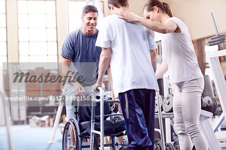 Physical therapists helping man with walker Stock Photo - Premium Royalty-Free, Image code: 6113-08521502