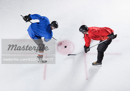 Hockey opponents in opening face off Stock Photo - Premium Royalty-Free, Image code: 6113-08698177
